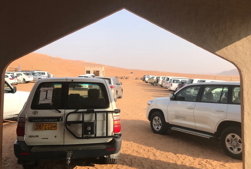 Jeeps, sand, tent. Desert.